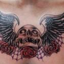 Tatuaje Calavera con alas en el pecho