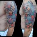 Tatuaje Carpa Koi en Brazo