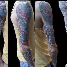 Tatuaje Tigre y Dragon Brazo Japones